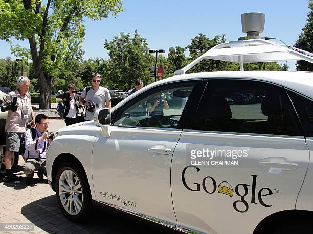 A Google selfdriving car is seen in Mountain View California on May 13 2014 A white Lexus cruised along a road near the Google campus braking for...