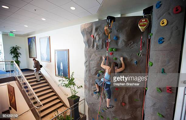 Google software engineer Amanda Camp demonstrates using the climbing wall during the grand opening of Google Kirkland October 28 2009 in Kirkland...