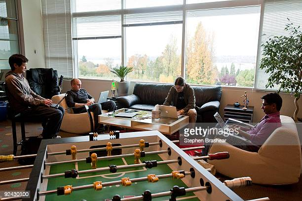 Google software engineers Keith Ito Nicholas Lee John Leen and Yatin Chawathe work in a room with a view and a foosball table at the newly opened of...