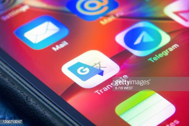 google translate - application close up on apple iphone xr - translation stock pictures, royalty-free photos & images