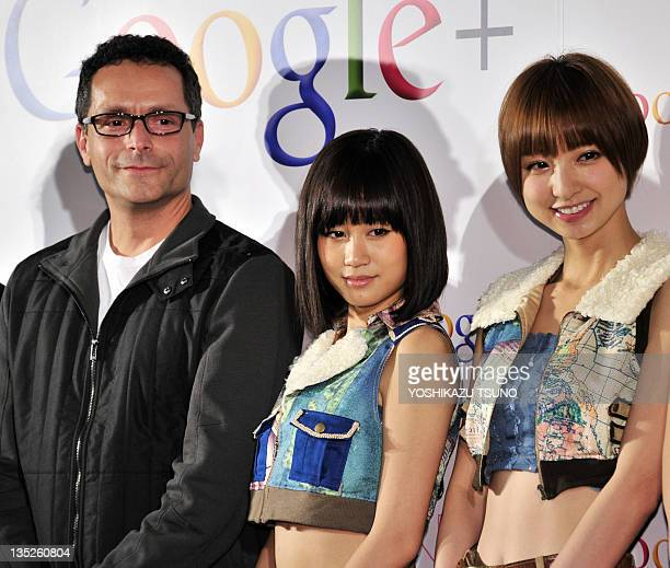 Google vice president Bradley Horowitz smiles with Japanese all-girl pop group AKB48 members Atsuko Maeda and Mariko Shinoda as they announce plans...