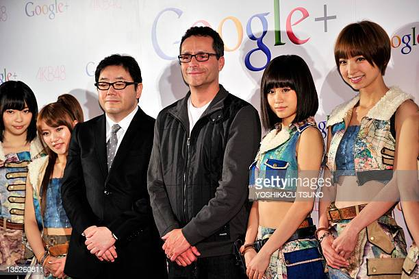 Google vice president Bradley Horowitz smiles with Japanese all-girl pop group AKB48 members Rino Sashihara , Minami Takahashi , Atsuko Maeda and...