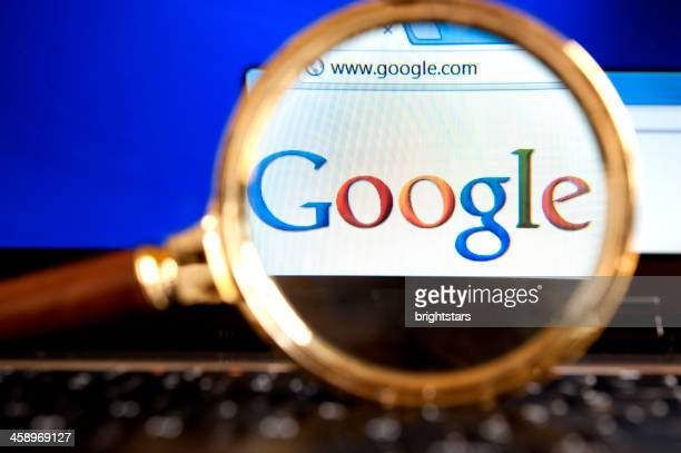 google website through a magnifying glass - google stock pictures, royalty-free photos & images