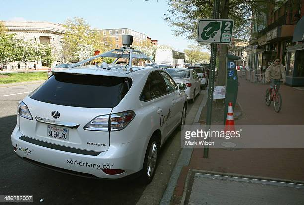 Googles Lexus RX 450H Self Driving Car is seen parked on Pennsylvania Ave on April 23 2014 in Washington DC Google has logged over 300000 miles...