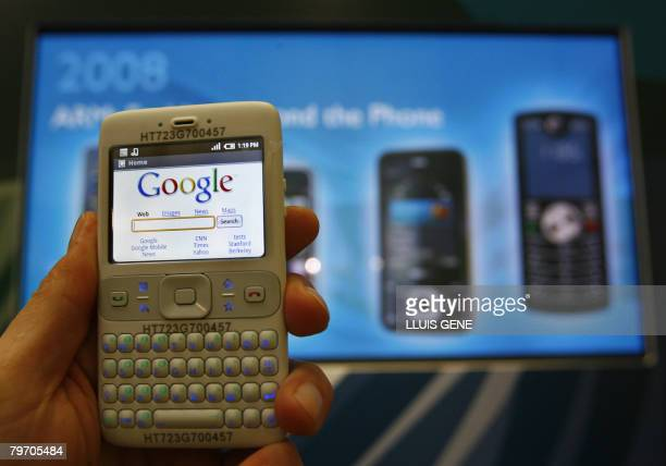 Google's new software platform for mobile phones entitled 'Android' in its prototype form on demonstration at the Mobile World Congress in Barcelona...