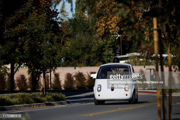 Google's self-driving car with two occupants inside drives by a Google's building on Mayfield Avenue in Mountain View on Nov. 13, 2015.