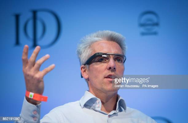 Google's UK managing director Dan Cobley wears 'Google Glass' during a QA session after he addressed the Institute of Directors annual conference at...