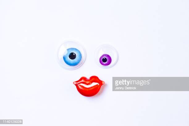 googly eyes and candy mouth - googly eyes stock pictures, royalty-free photos & images