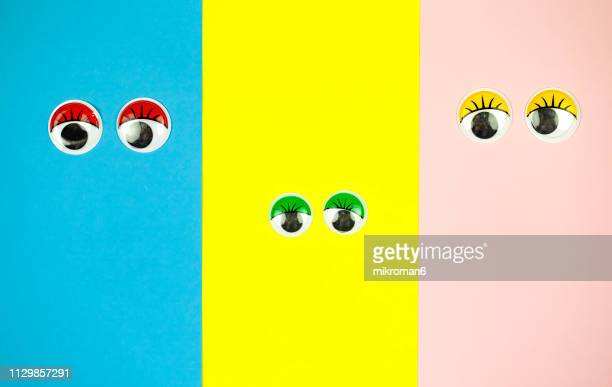 googly eyes looking up on colored background - pop art stock pictures, royalty-free photos & images