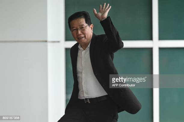 Gooi Soon Seng the lawyer for Indonesian defendant Siti Aisyah waves as he arrives at the Malaysian Chemistry Department in Petaling Jaya outside...