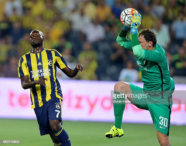 Goolkeeper Andriy Pyatov of Shaktar Donetsk saves the ball in front of Fenerbahce's Moussa Sow during UEFA Champions League Third Qualifying Round...