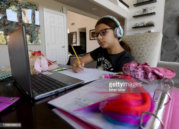 Goolsby Elementary School fourth grader Luca Conrad takes an online class at her home during the first week of distance learning for the Clark County...