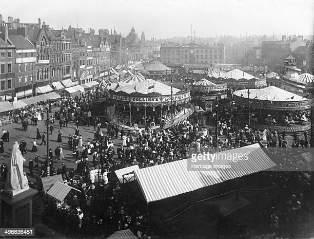 Goose Fair Market Place Nottingham Nottinghamshire 1908 East aspect looking towards The Exchange from Beastmarket Hill during a heatwave Queen...