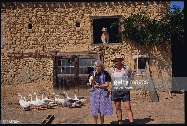 Goose Farmers Standing with Puppy