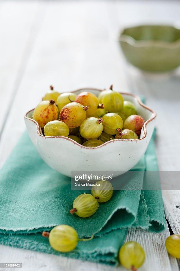 Gooseberries in white bowl : Stock Photo