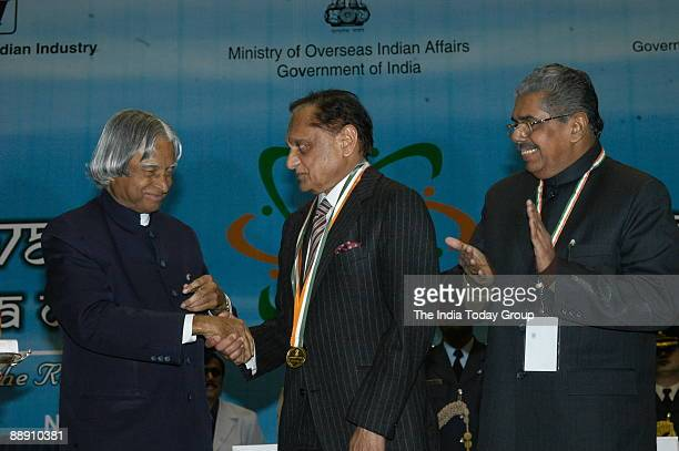 Gopal Raju from USA shakes hand with APJ Abdul Kalam President of India along with Vayalar Ravi Union Cabinet Minister for Overseas Indian Affairs at...