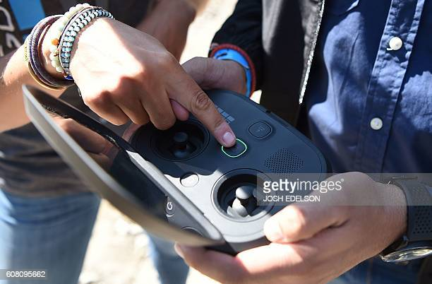 A GoPro employee describes how to pilot a new foldable Karma drone during a press event in Olympic Valley California on September 19 2016 / AFP /...
