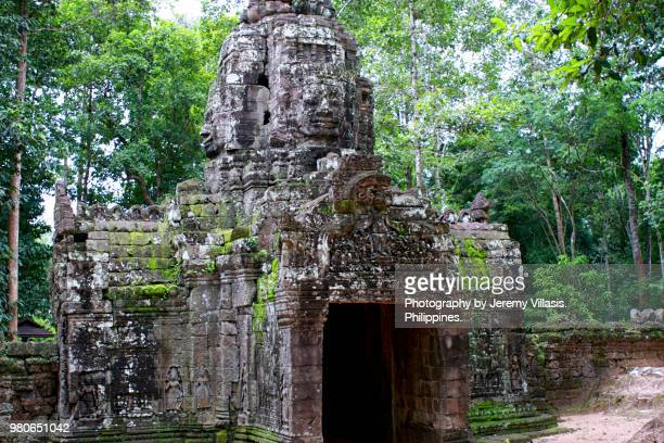 gopura face-tower, ta som, angkor - old ruin stock photos and pictures