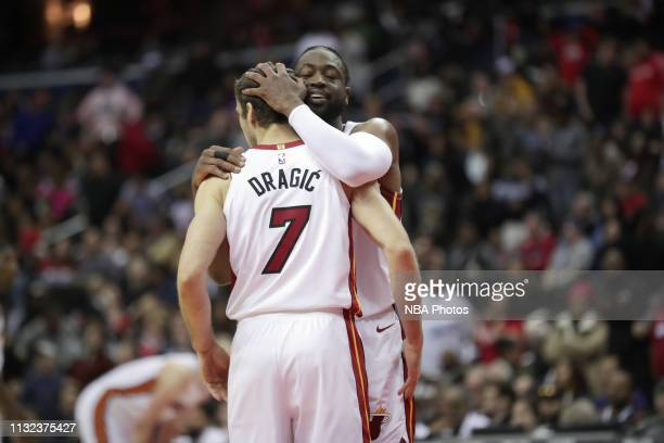 Goran Dragic and Dwyane Wade of the Miami Heat huge after the game against the Washington Wizards on March 23 2019 at Capital One Arena in Washington...