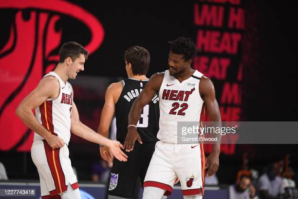 Goran Dragic and Jimmy Butler of the Miami Heat hi-five during a scrimmage against the Sacramento Kings on July 22, 2020 at HP Field House at ESPN...