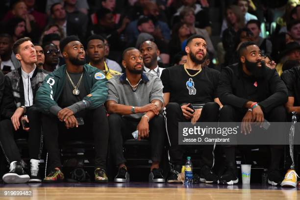 Goran Dragic Jaylen Brown Kemba Walker JaVale McGee and James Harden look on during the Verizon Slam Dunk Contest during State Farm AllStar Saturday...