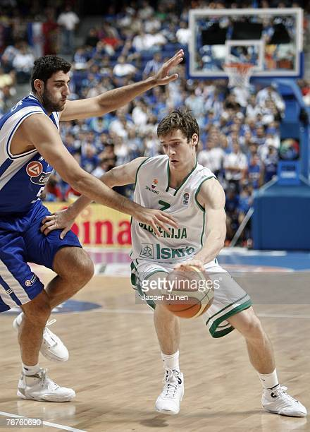 Goran Dragic of Slovenia drives around Ioannis Bourousis of Greece during the FIBA Eurobasket 2007 quarter final match between Slovenia and Greece at...