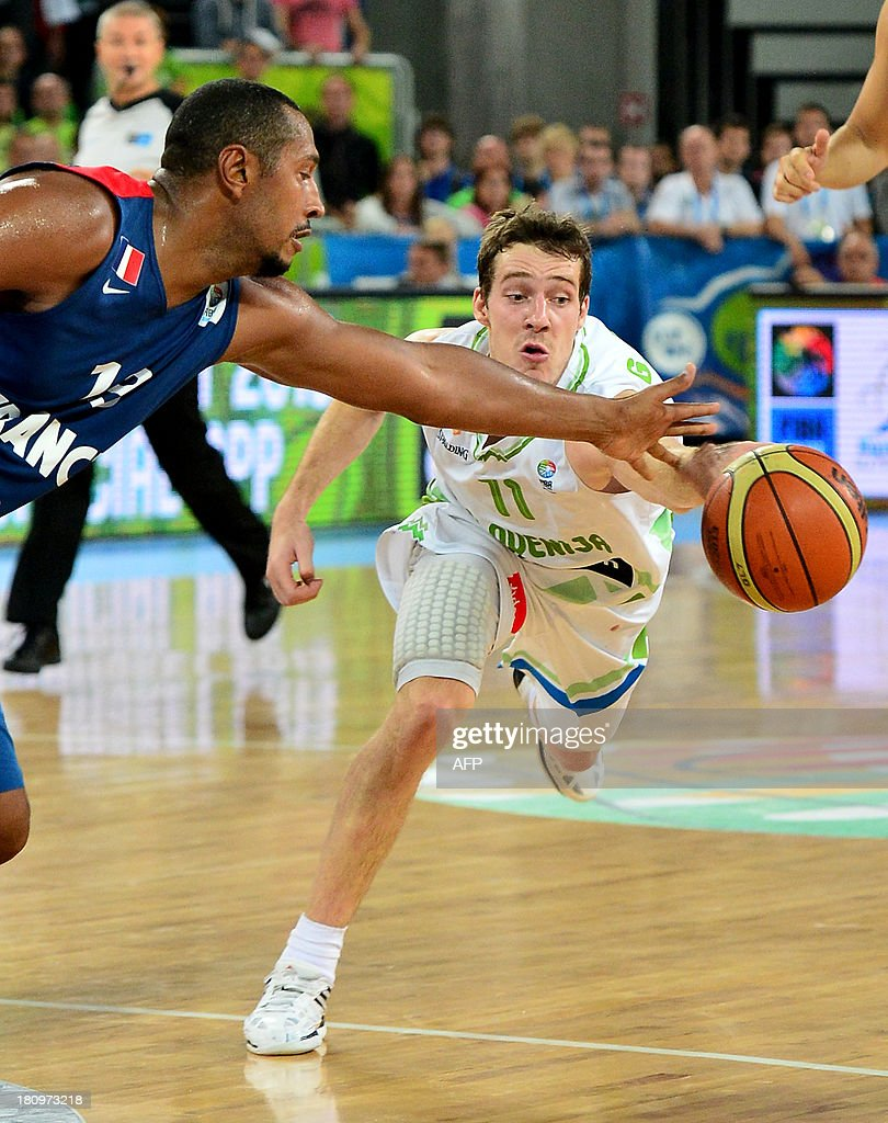 Goran Dragic (R) of Slovenia vies with Boris Diaw of France during the FIBA European basketball championship quarter final match between Slovenia and France in Ljubljana, Slovenia, on September 18, 2013.