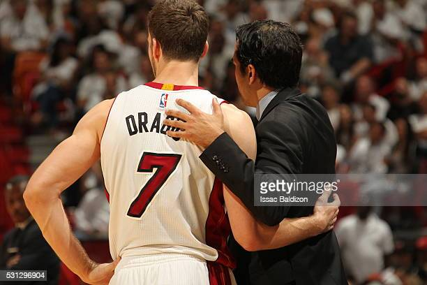 Goran Dragic of the Miami Heat and Head Coach Erik Spoelstra of the Miami Heat during the game against the Toronto Raptors in Game Six of the Eastern...