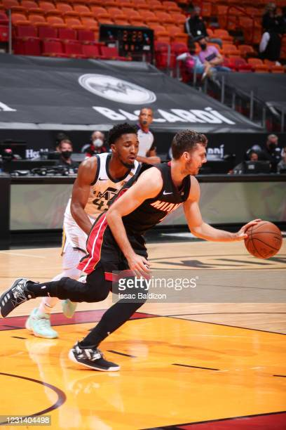 Goran Dragic of the Miami Heat dribbles during the game as Donovan Mitchell of the Utah Jazz plays defense on February 26, 2021 at American Airlines...