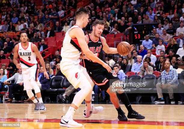 Goran Dragic of the Miami Heat drives against CJ McCollum of the Portland Trail Blazers in the second quarter at American Airlines Arena on December...