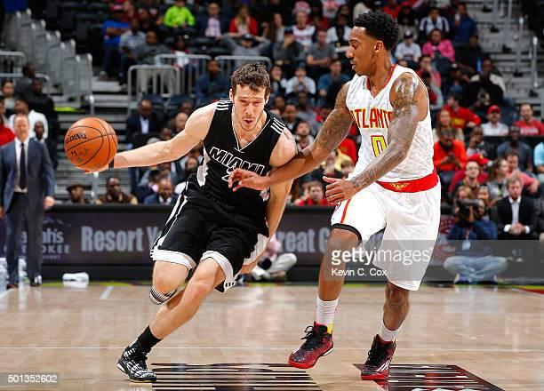 Goran Dragic of the Miami Heat drives against Jeff Teague of the Atlanta Hawks at Philips Arena on December 14 2015 in Atlanta Georgia NOTE TO USER...