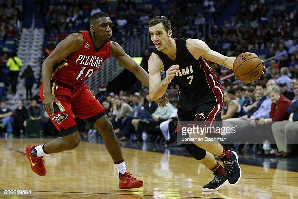 Goran Dragic of the Miami Heat drives against Langston Galloway of the New Orleans Pelicans during the second half of a game at the Smoothie King...