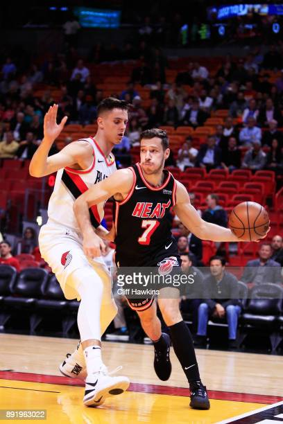 Goran Dragic of the Miami Heat drives against Zach Collins of the Portland Trail Blazers in the first quarter at American Airlines Arena on December...