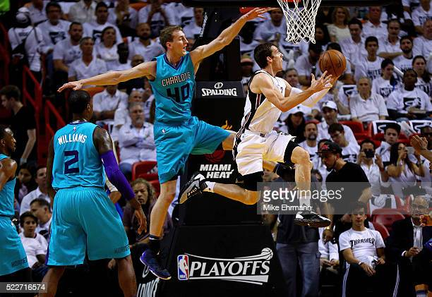 Goran Dragic of the Miami Heat drives on Cody Zeller of the Charlotte Hornets during game two of the Eastern Conference Quarterfinals of the 2016 NBA...