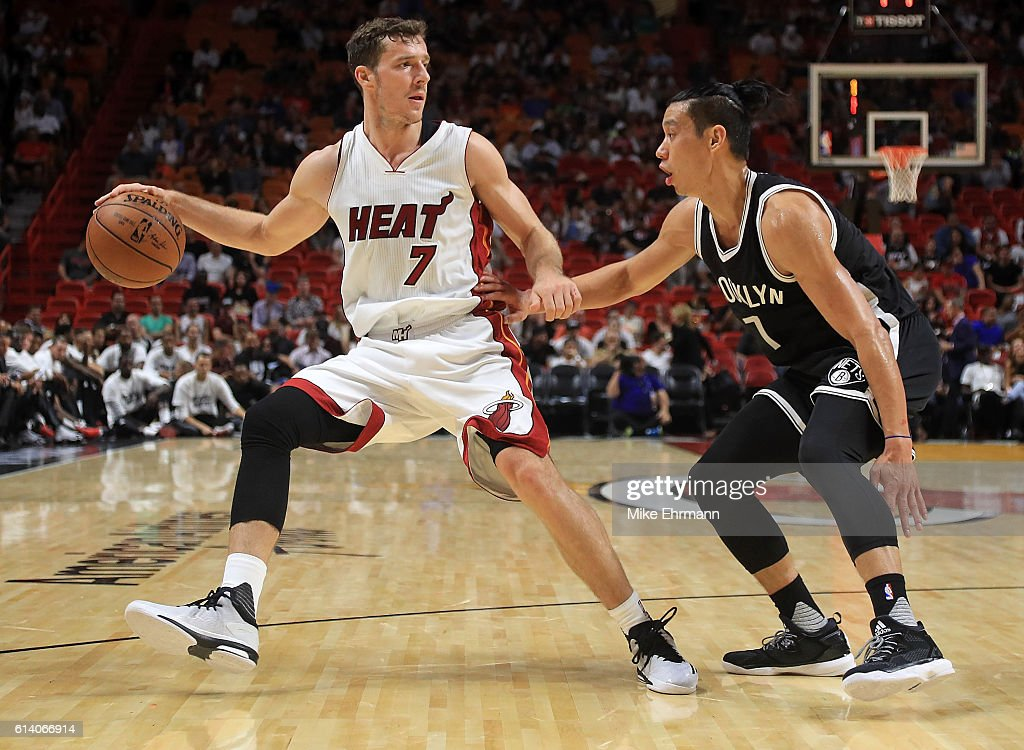 Goran Dragic #7 of the Miami Heat drives on Jeremy Lin #7 of the Brooklyn Nets during a preseason game at American Airlines Arena on October 11, 2016 in Miami, Florida.