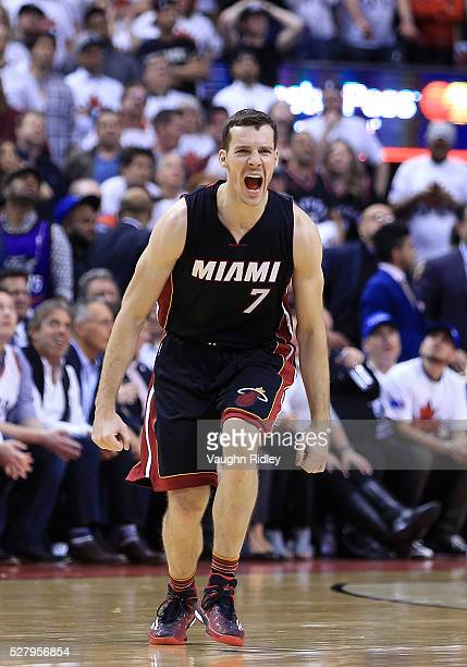 Goran Dragic of the Miami Heat gestures to his teammates in the second half of Game One of the Eastern Conference Semifinals against the Toronto...