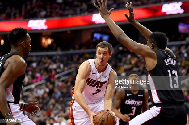 Goran Dragic of the Miami Heat looks to pass in front of Thomas Bryant of the Washington Wizards during the first half at Capital One Arena on March...