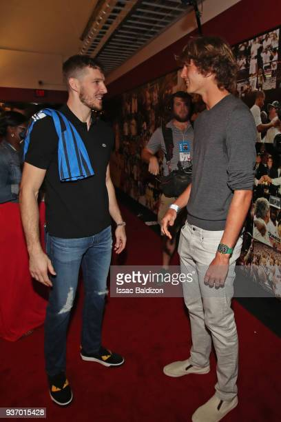 Goran Dragic of the Miami Heat talks with Tennis Player Alexander Zverev after the game against the New York Knicks on March 21 2018 at American...