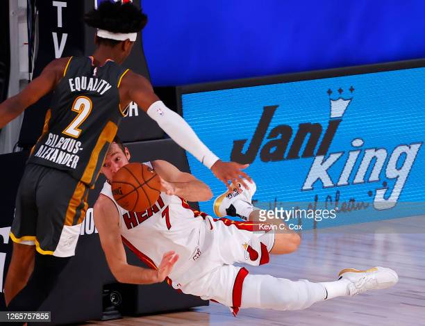 Goran Dragic of the Miami Heat tries to save the ball from going out of bounds against Shai Gilgeous-Alexander of the Oklahoma City Thunder during...