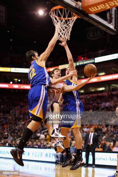 Goran Dragic of the Phoenix Suns attempts a layup shot against Andrew Bogut and Klay Thompson of the Golden State Warriors during the second half of...