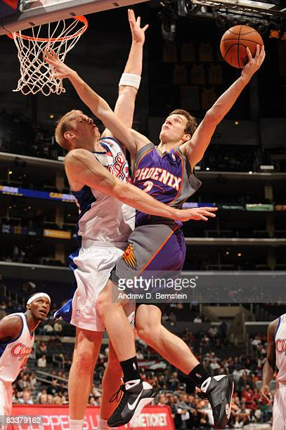 Goran Dragic of the Phoenix Suns attempts a shot against Chris Kaman of the Los Angeles Clippers at Staples Center on October 21 2008 in Los Angeles...