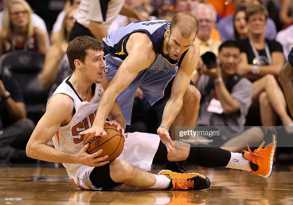 Goran Dragic #1 of the Phoenix Suns attempts to control the ball under pressure from Nick Calathes #12 of the Memphis Grizzlies during the first half of the NBA game at US Airways Center on April 14, 2014 in Phoenix, Arizona.