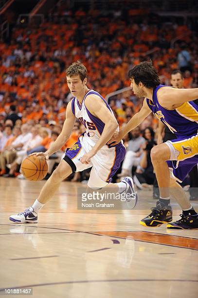 Goran Dragic of the Phoenix Suns dribbles against Sasha Vujacic of the Los  Angeles Lakers in 4aebd5db0