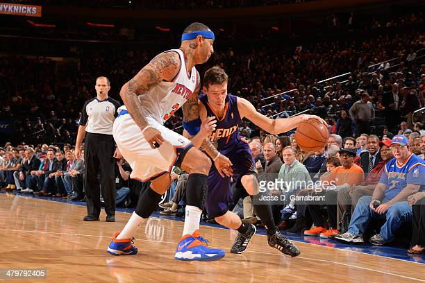 Goran Dragic of the Phoenix Suns drives against Kenyon Martin of the New York Knicks on January 13 2014 at Madison Square Garden in New York City New...