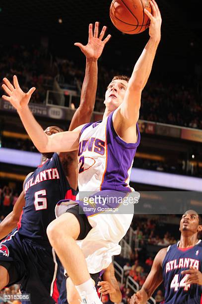 Goran Dragic of the Phoenix Suns drives against Mario West of the Atlanta Hawks in an NBA game played on October 8 at US Airways Center in Phoenix...