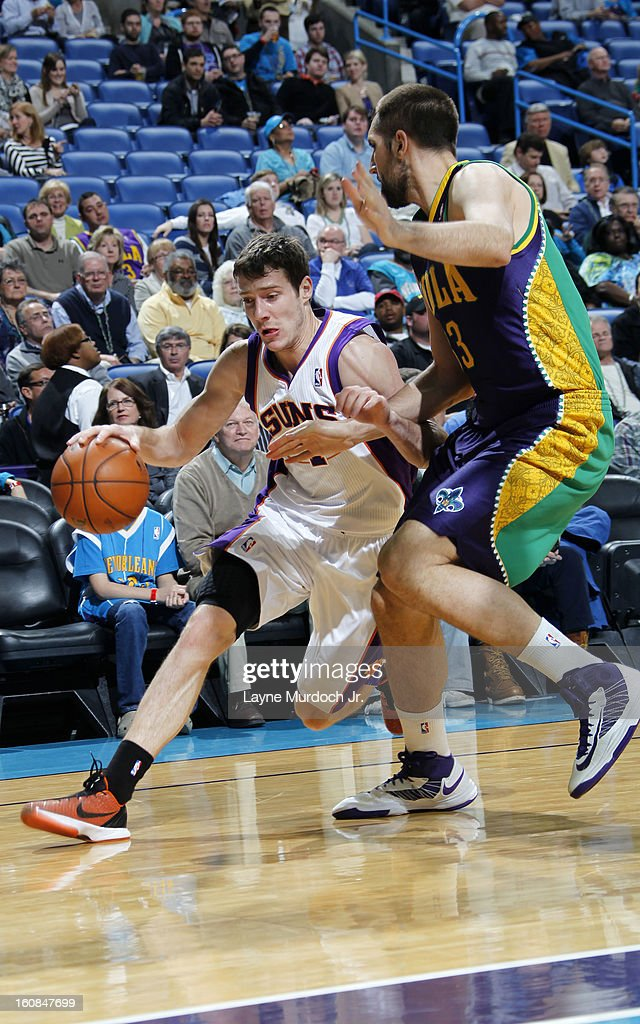 Goran Dragic #1 of the Phoenix Suns drives against Ryan Anderson #33 of the New Orleans Hornets on February 06, 2013 at the New Orleans Arena in New Orleans, Louisiana.