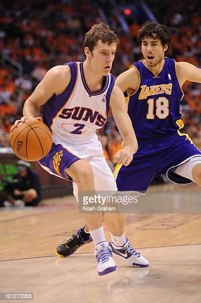 Goran Dragic of the Phoenix Suns drives against Sasha Vujacic of the Los  Angeles Lakers in a85b42549