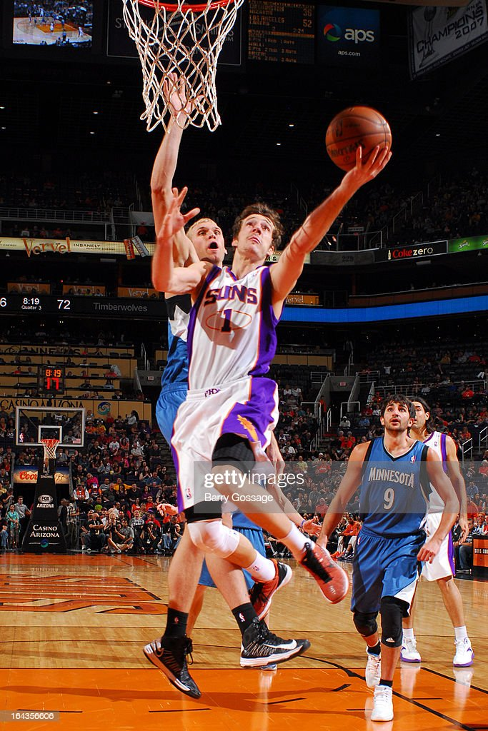 Goran Dragic #1 of the Phoenix Suns drives for a shot against Greg Stiemsma #34 of the Minnesota Timberwolves on March 22, 2013 at U.S. Airways Center in Phoenix, Arizona.