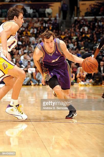 Goran Dragic of the Phoenix Suns drives the ball up court against Sasha  Vujacic of the. Phoenix Suns v Los Angeles Lakers 099aab272