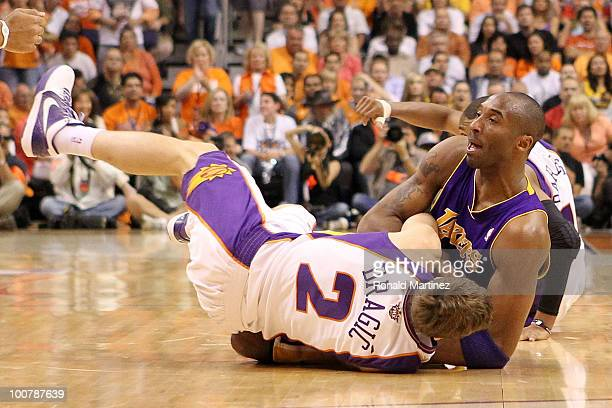 Goran Dragic of the Phoenix Suns fights for a loose ball with Kobe Bryant of the Los Angeles Lakers in the second quarter of Game Four of the Western...